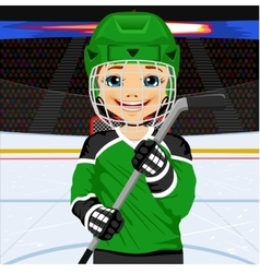 Young hockey player in uniform vector