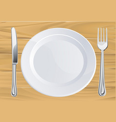Plate and cutlery on wooden table vector
