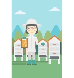 Female bee-keeper at apiary vector