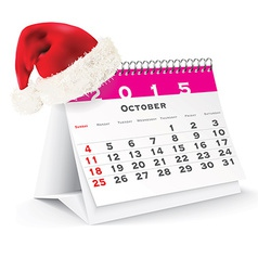 October 2015 desk calendar with christmas hat vector