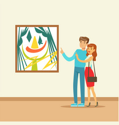 Young couple in modern art gallery looking at the vector