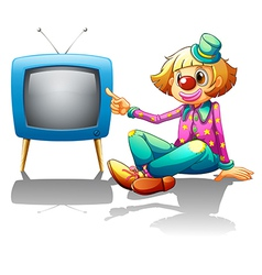 A clown sitting beside the television vector image