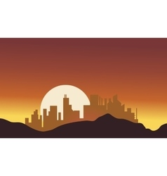 Silhouette of city with big moon vector image