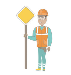Young hispanic road worker showing road sign vector