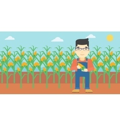 Farmer holding corn vector