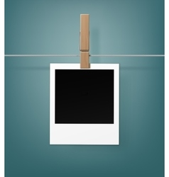 Wooden peg with retro photo frame on rope vector
