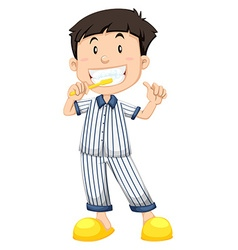 Boy in striped pajamas brushing teeth vector