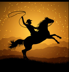 Silhouette of cowboy with lasso on rearing horse vector