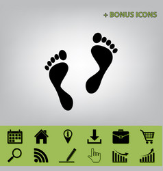 Foot prints sign black icon at gray vector