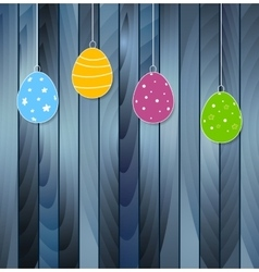 Flat easter eggs on blue wooden texture background vector