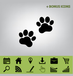 Animal tracks sign black icon at gray vector