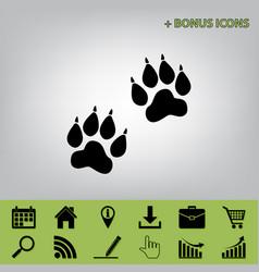 Animal tracks sign black icon at gray vector
