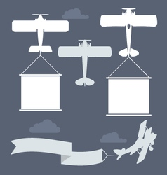 Flying biplanes with blank greetings banner vector
