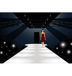 Fashion model in red dress walking down a catwalk vector