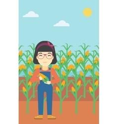 Female farmer holding corn vector