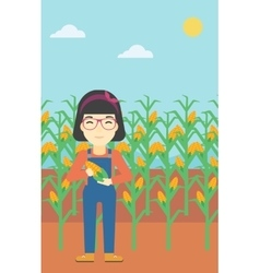 Female farmer holding corn vector