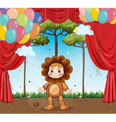 Kid in lion costume on stage vector