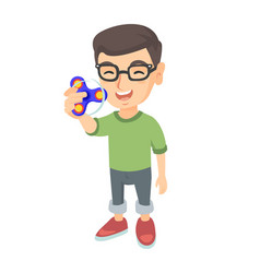 Caucasian little boy playing with fidget spinner vector