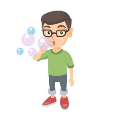 Little caucasian boy blowing soap bubbles vector