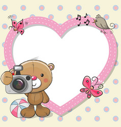 teddy bear with a camera and a heart frame vector image vector image
