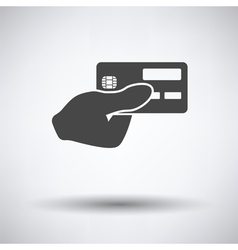 Hand holding credit card icon vector