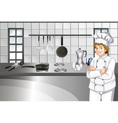 Chef in white uniform working in kitchen vector