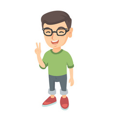 Caucasian little boy showing victory gesture vector