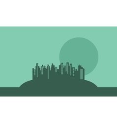 Silhouette of buildings in hills vector