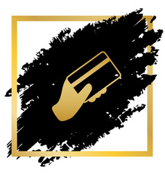 Hand holding a credit card golden icon at vector