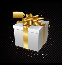 gold gift with sparkles isolated on black vector image vector image