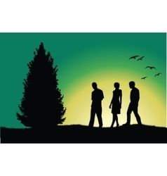 Two men and girl walking on hill near tree green vector