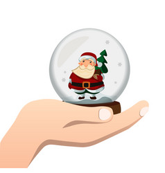 hand holds a glass ball with santa vector image vector image
