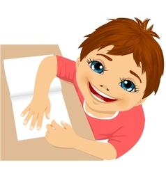 cute boy doing homework top view vector image vector image