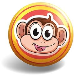 Monkey head on round badge vector