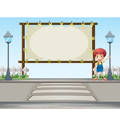 A boy waving his hand near a signboard vector image vector image