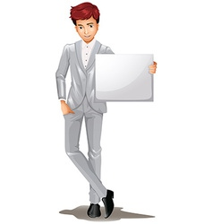 A handsome man holding an empty signage vector image