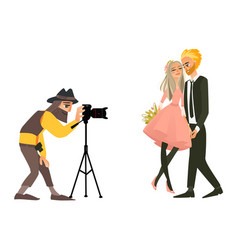 photographer shooting a wedding couple vector image vector image
