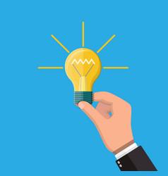 glass light bulbin hand vector image
