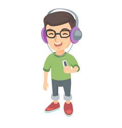 Caucasian boy listening to music in headphones vector