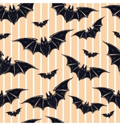Seamless background with bats vector