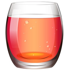 A clear drinking glass with juice vector