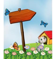 A garden with butterflies and a cat near an vector image