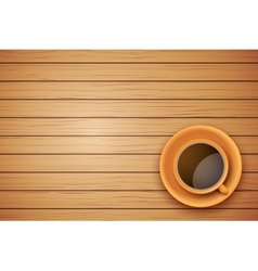 Orange cup of coffee or tea on the table dark wood vector