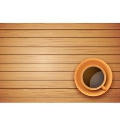 Orange cup of coffee or tea on the table dark wood vector