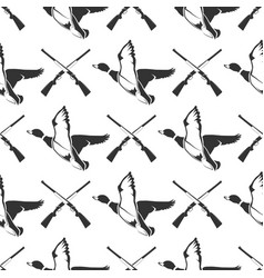 Hunting seamless pattern with guns and ducks vector