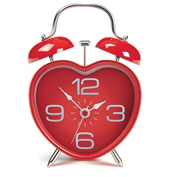 Heart shaped alarm clock vector
