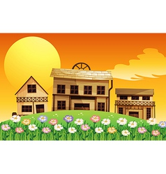 A sunset scene with wooden houses vector
