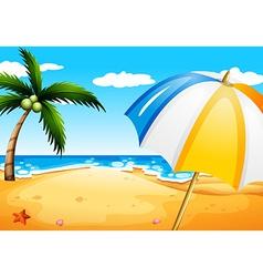 A beach with an umbrella vector