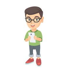caucasian boy using a smartphone vector image