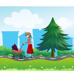 A girl with a baby stroller along the road vector image vector image